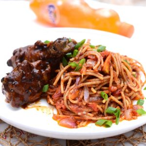 Jollof spaghetti and Barbecue chicken
